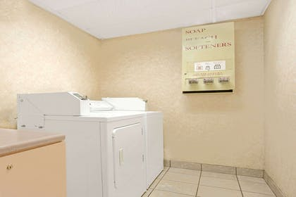 Guest Laundry | Days Inn & Suites by Wyndham Kansas City South