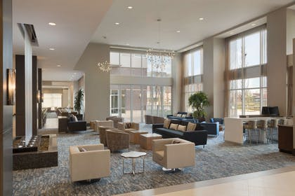 Reception | Embassy Suites by Hilton The Woodlands at Hughes Landing