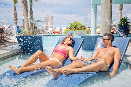 Pool Lounge Chairs and Fountain | Best Western Premier The Tides