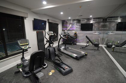 Maintain your fitness routine during your stay with us in our fitness center. | Best Western Plus Bay City Inn & Suites