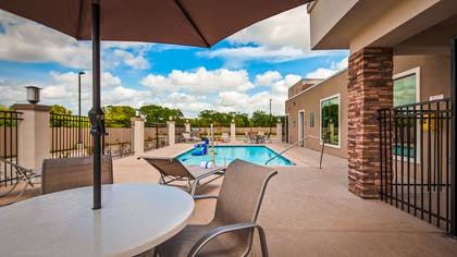 Whether you want to relax poolside or take a dip, our outdoor pool area is the perfect place to unwind. | Best Western Plus Bay City Inn & Suites