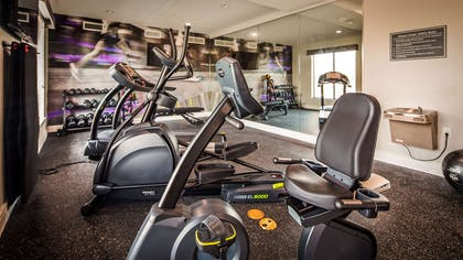 Enjoy our 24-hour fitness center with state-of-the-art cardio and weigh equipment for your convenience. | Best Western Plus Bay City Inn & Suites