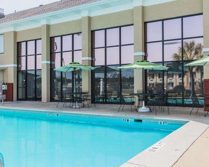Outdoor pool with sundeck | Quality Inn & Suites near Gunter Annex Air Force Base