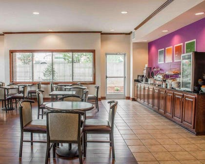 Enjoy breakfast in this seating area | Comfort Suites Huntsville Research Park Area