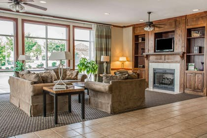 Relax by the fireplace in the lobby | Comfort Suites Huntsville Research Park Area