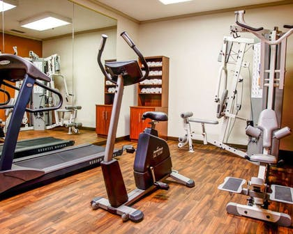 Exercise room with cardio equipment and weights | Comfort Suites Gadsden Attalla