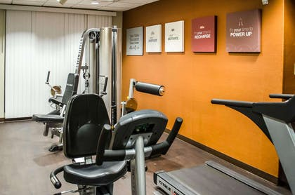 Exercise room with cardio equipment and weights | Comfort Suites Mobile
