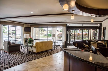 Spacious lobby with sitting area | Comfort Suites North Mobile