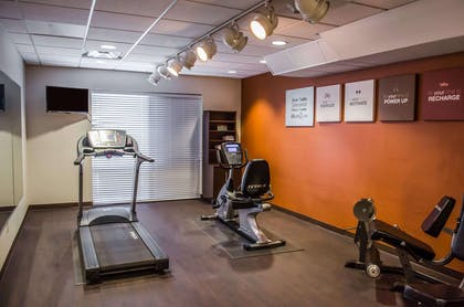 Exercise room with cardio equipment | Comfort Suites North Mobile