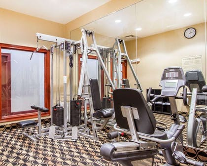 Fitness center with cardio equipment and weights | Quality Inn & Suites Greenville I-65