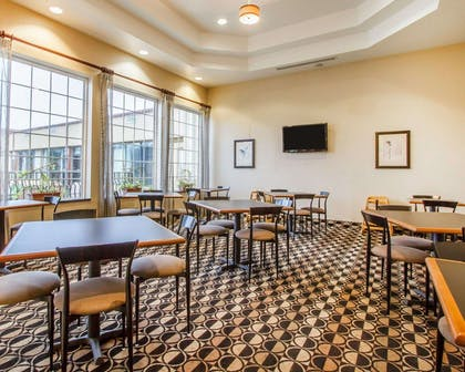 Enjoy breakfast in this spacious area | Quality Inn & Suites Greenville I-65
