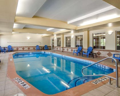Indoor pool with sitting area | Sleep Inn & Suites Springdale West
