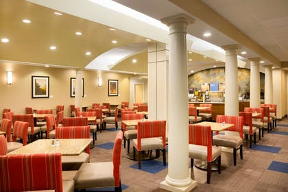 Enjoy breakfast in this seating area | Comfort Inn & Suites Presidential