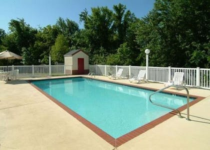 Outdoor pool with sundeck | Quality Inn & Suites I-40 East