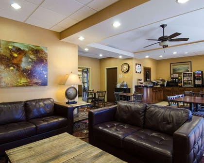 Spacious lobby with sitting area | MainStay Suites Rogers near I-49