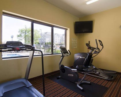 Fitness center with television | MainStay Suites Rogers near I-49