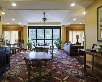 Breakfast sitting area | MainStay Suites Rogers near I-49