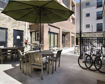 Relax on the hotel patio | MainStay Suites Rogers near I-49