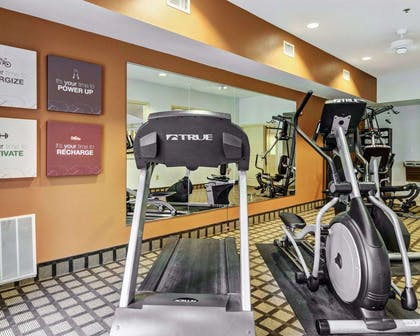 Exercise room with cardio equipment and weights | Comfort Suites near Hot Springs Park