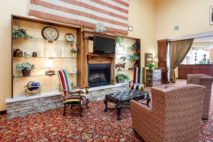 Relax by the lobby fireplace | Comfort Suites West Memphis I-40 I-55
