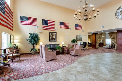 Spacious lobby with sitting area | Comfort Suites West Memphis I-40 I-55