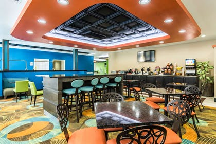 Enjoy breakfast in this seating area | Clarion Inn & Suites Russellville I-40