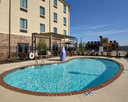 Outdoor pool | Comfort Inn & Suites Fort Smith I-540