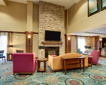 Relax by the fireplace in the lobby | Comfort Suites