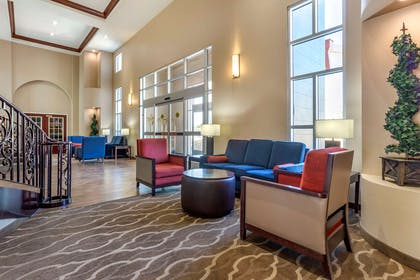 Spacious lobby with sitting area | Comfort Suites Phoenix Airport
