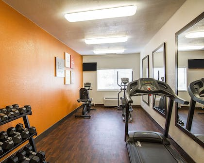 Fitness center with cardio equipment and weights | Comfort Suites Peoria Sports Complex