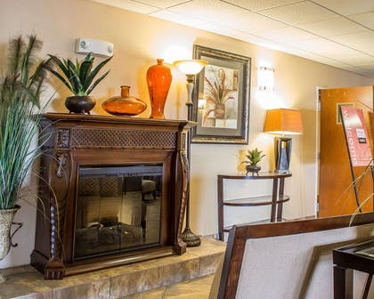 Relax by the fireplace in the lobby | Comfort Inn & Suites Thatcher - Safford