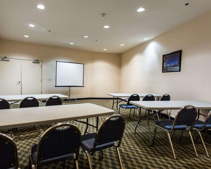 Meeting room with classroom-style setup | Quality Inn & Suites