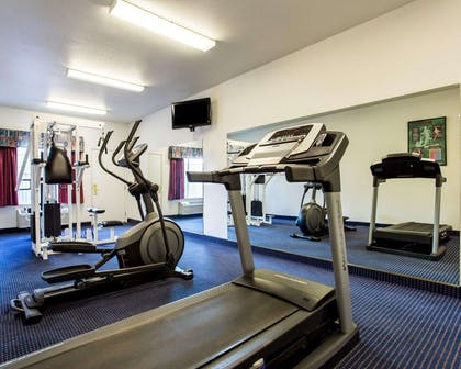 Exercise room with cardio equipment | Quality Inn & Suites
