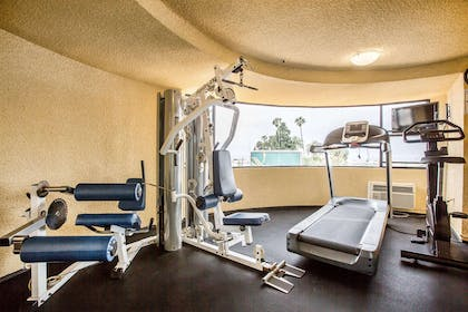 Fitness center with cardio equipment and weights   Quality Inn & Suites Hermosa Beach