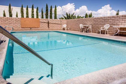 Outdoor pool with sundeck | Econo Lodge Inn & Suites near China Lake Naval Station