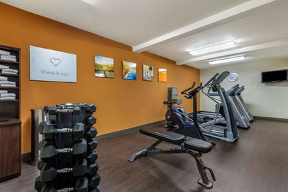 Exercise room with cardio equipment and weights | Comfort Suites Visalia Convention Center
