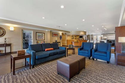 Spacious lobby with sitting area | Comfort Suites Visalia Convention Center