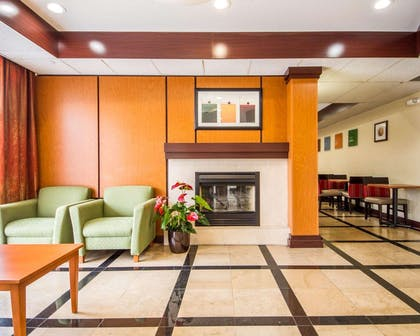 Relax by the fireplace in the lobby | Comfort Inn & Suites Oakland