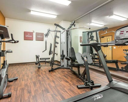 Fitness center with cardio equipment and weights | Comfort Suites Palm Desert I-10
