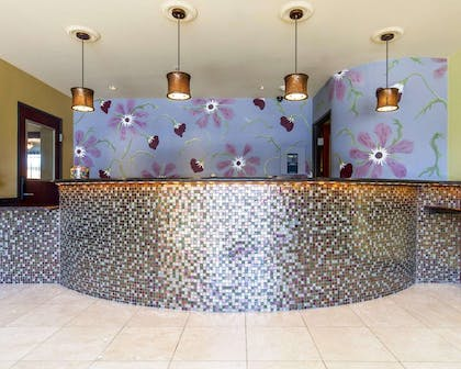 Front desk with friendly staff   Villa Montes Hotel, an Ascend Hotel Collection Member