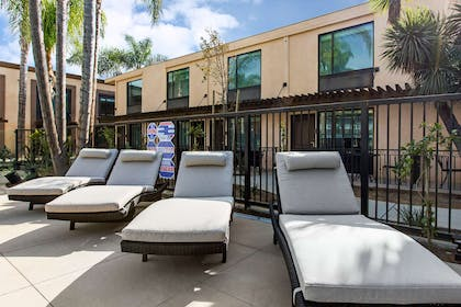 Poolside lounge chairs   The Cove Hotel, an Ascend Hotel Collection Member