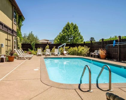 Outdoor pool with sundeck | Comfort Inn & Suites