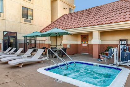 Relax in the hot tub   Comfort Suites Barstow near I-15