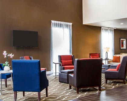 Spacious lobby with sitting area | Comfort Suites Woodland - Sacramento Airport