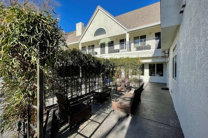 Relax on the sundeck | Aggie Inn, an Ascend Hotel Collection Member