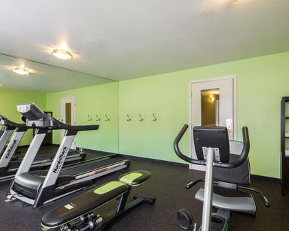 Fitness center with cardio equipment and weights | Hotel Med Park, an Ascend Hotel Collection Member