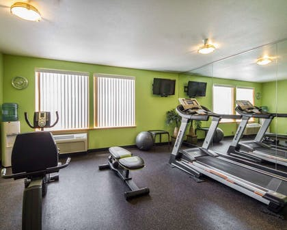 Fitness center with television | Hotel Med Park, an Ascend Hotel Collection Member