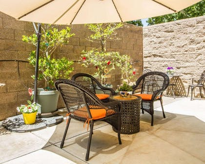 Relax on the hotel patio | Hotel Med Park, an Ascend Hotel Collection Member