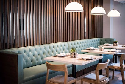Dining room seating | Cambria Hotel LAX