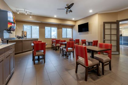 Enjoy breakfast in this seating area | Comfort Suites Highlands Ranch Denver Tech Center Area